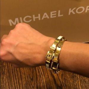 Michael Kors Bracelets. 2 buckle White / gold tone